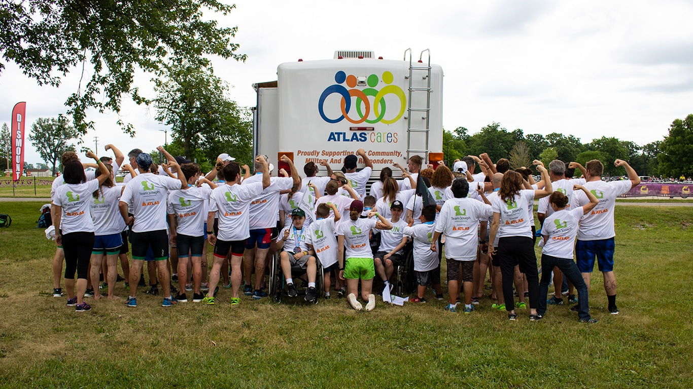The Atlas Cares and Team Joseph teams pose after completing the Motor City Triathlon.