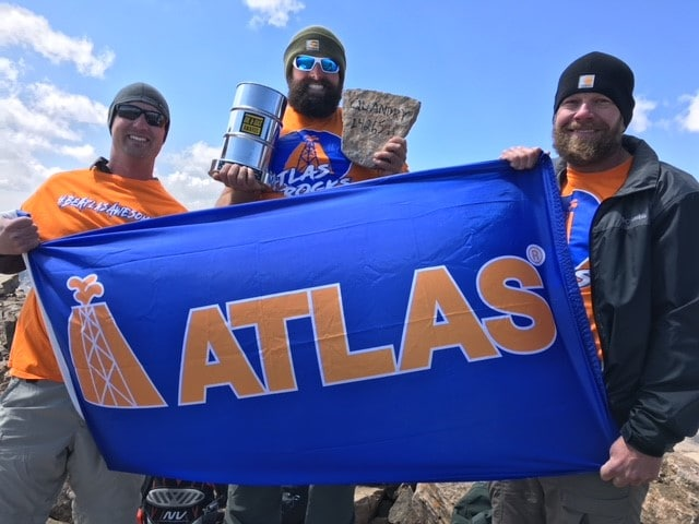 Atlas team members hiked to the top of a mountain with the Excellence in Health and Safety Award.