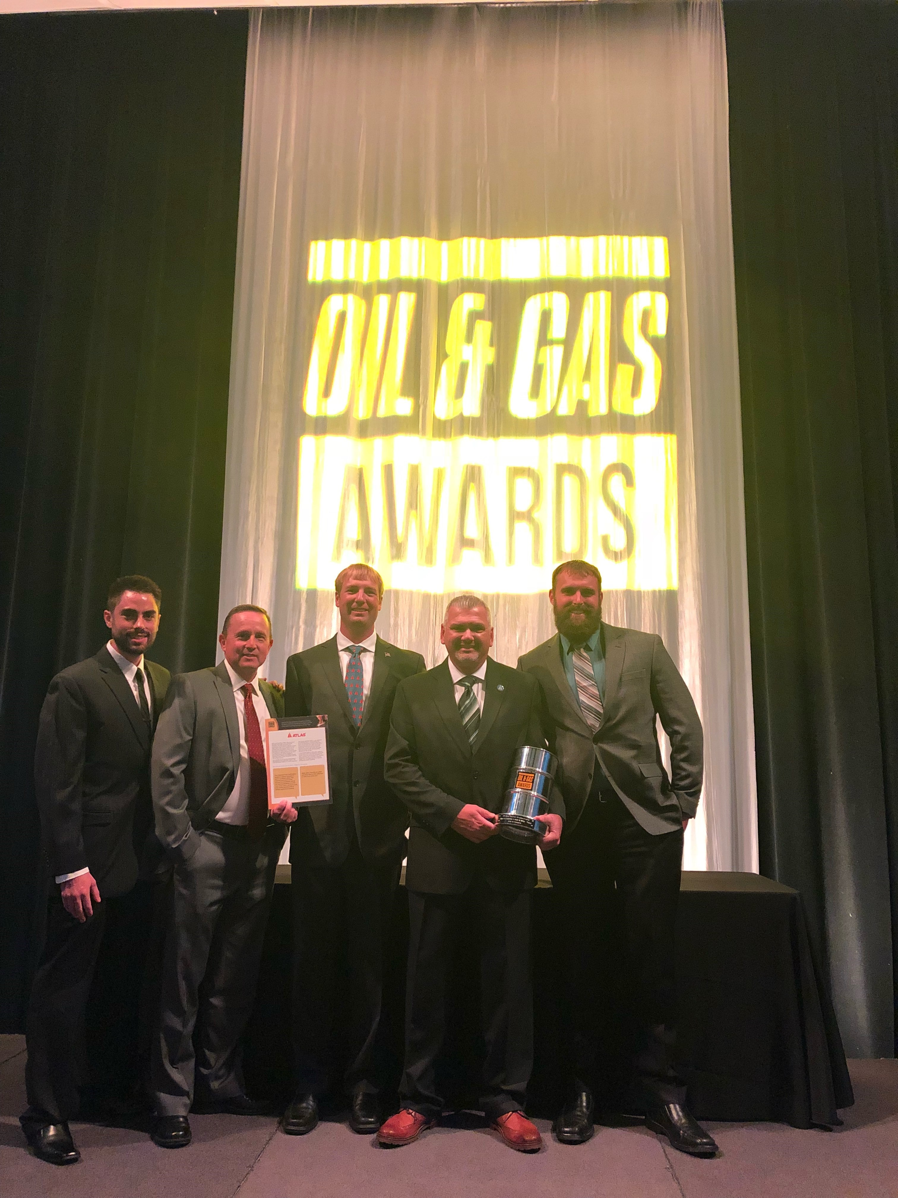 Atlas leadership poses with the Rocky Mountain Oil and Gas Awards